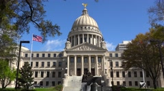 Nice establishing shot of the capital building in jackson Mississippi with flag Stock Footage