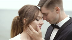 Bridegroom Holding Gently Hand on Bride's Face Stock Footage