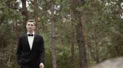 Bridegroom Walking and Holding a Hand in a Pocket Stock Footage