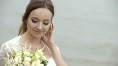 Charming Bride Holding a Delicate Wedding Bouquet Stock Footage