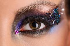 Reflection of the city in makeup eye. Close up Stock Photos