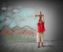 Child playing with wooden plane Stock Photos
