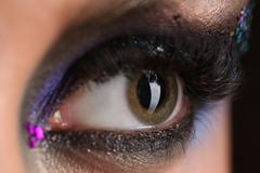 Smokey eye with colorful crystals. Close up Stock Photos
