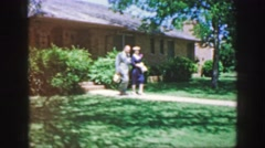 1961: well-dressed couple strolls along path toward onlooker IOWA Stock Footage
