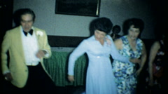 Wedding guest dancing at the newlyweds reception 3573-vintage film home movie Stock Footage
