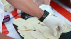 Close-up of cook's hands working with Mexican tortillas Stock Footage