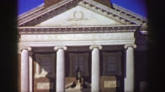 1961: men pass in front of old mansion IOWA Stock Footage