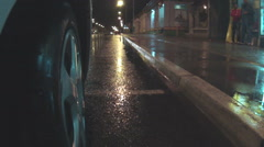 The front wheel of a car on a rainy night Stock Footage