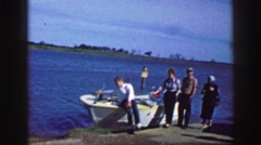 1961: people are seen posing beside a boat IOWA Stock Footage