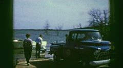 1961: friends put boat into water IOWA Stock Footage