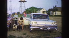 1961: women exiting a vehicle and being greeted by a couple of cute dogs IOWA Stock Footage