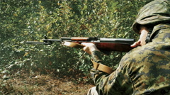 4K Loud Gun Shot, Soldier Firing Large Caliber Rifle, Green Camouflage Uniform Stock Footage