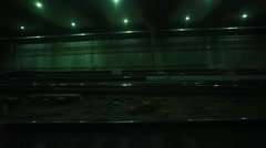 Point of view shot of dark, empty subway station from inside moving train Stock Footage