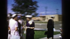 1961: a gathering is seen talking and a close up is done on a broach IOWA Stock Footage