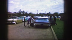 1961: a family is seen entering a car IOWA Stock Footage