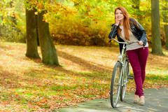 Fashionable girl with bike. Stock Photos