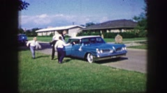 1961: children are seen throwing things at a car in fun IOWA Stock Footage