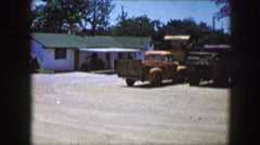 1961: view of the yard in front of a typical farmhouse. IOWA Stock Footage