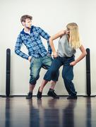 Couple of young man and woman dancing hip-hop Stock Photos