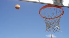 Basketball hits the hoop and misses its target, in slow motion Stock Footage
