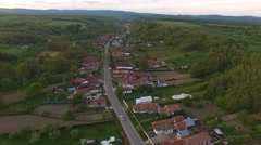 Aerial view over houses in the Transylvanian countryside at sunset Stock Footage