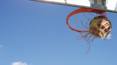 Basketball scores through the hoop, in slow motion Stock Footage