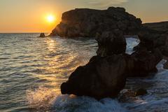 Sun rises over the Sea of Azov on Generals beach. Karalar regional landscape Stock Photos