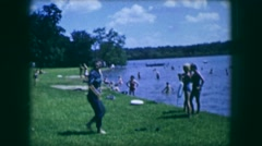 1961: a beautiful day out with family and neighbors at the beach catching some Stock Footage