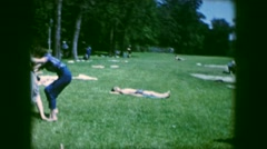 1961: woman and children wrestling and playing at a picnic IOWA Stock Footage