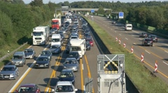 4K German Autobahn Traffic Jam car driver outside of their auto Germany Europe Stock Footage