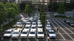 Taxis waiting for customers around Hakata subway station in Fukuoka Stock Footage