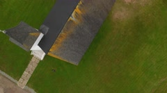 Aerial shot above a beautiful rural church at Cape Breton Island Stock Footage