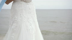 Tender Bride in Lace Dress Standing Near the Lake Stock Footage