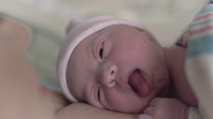 Close Up of Newborn Baby Yawning and Laying Head on Mothers Breast Stock Footage