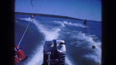 1961: water skiing with friends on the lake in the sun IOWA Stock Footage