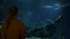 Young woman in Bangkok, Thailand at the oceanarium of Siam Ocean World watching Stock Footage