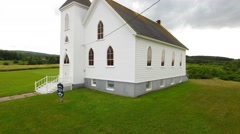 Aerial shot above a beautiful small church at Cape Breton Island Stock Footage