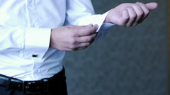 Stylish Groom buttons his shirt cuffs preparing for the wedding dress Stock Footage