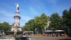 People walking on the Brink in Deventer, Wilhemina fountain Stock Footage