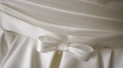 Wedding dress close-up on a background of a wall hanging on the hanger Stock Footage