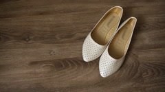 Bride's shoes on the floor 3 Stock Footage