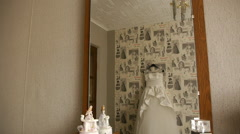 A reflection of a wedding dress in the mirror Stock Footage