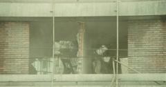 Excavator mechanical arm destroys building bricks Stock Footage