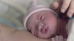 Macro Shot of Newborn Baby Girl in Hospital Laying on Mothers Chest Licking Stock Footage