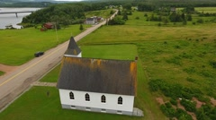 Aerial shot at a beautiful small church at Cape Breton Island Stock Footage