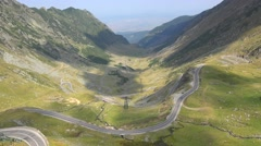 Cars driving on difficult mountain road, Transfagarasan, Romania Stock Footage