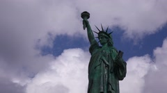 A patriotic shot of the Statue Of Liberty against a cloudy sky. Stock Footage