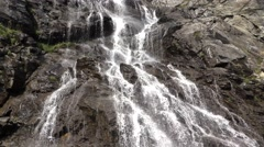 Wild waterfall in rocky mountains Stock Footage