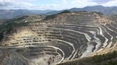 Mining quarry and trucks carrying the ore Stock Footage