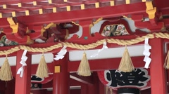 Good luck charms hanging on poles of Dazaifu shrine in Fukuoka Stock Footage